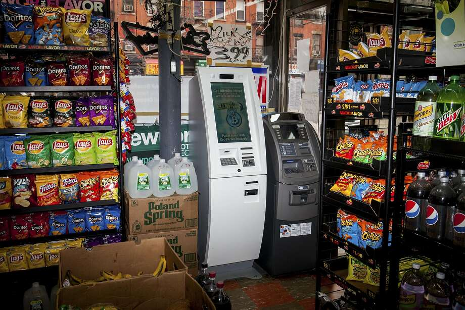 Central banks do not want their institutions to own or use bitcoin itself, like that offered at this ATM in New York, but some want to use bitcoin's decentralized method of record-keeping. Photo: DANNY GHITIS, NYT