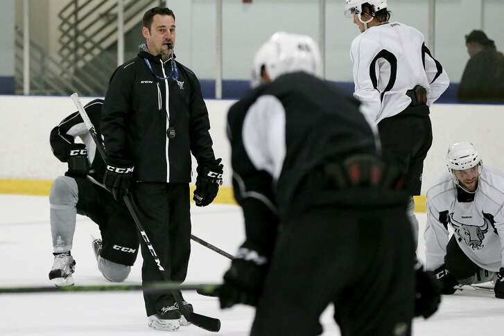 Rampage head coach Eric Veilleux (left) during a practice session at the Ice Center at Northwoods on Oct. 12, 2016.