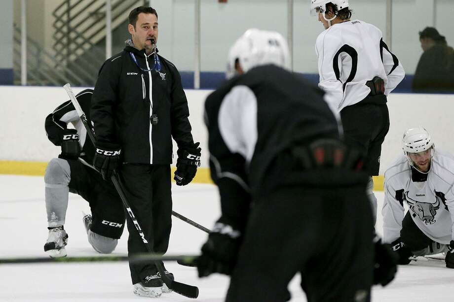 Rampage head coach Eric Veilleux (left) works with his team during a practice session at the Ice & Golf Center at Northwoods on Oct. 12, 2016. Photo: Marvin Pfeiffer /San Antonio Express-News / Express-News 2016