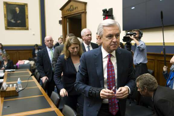 FILE - In this Thursday, Sept. 29, 2016, file photo, Wells Fargo CEO John Stumpf leaves a hearing room on Capitol Hill in Washington,  after testifying before the House Financial Services Committee investigating Wells Fargo's opening of unauthorized customer accounts. Embattled CEO Stumpf is out effective immediately, with President and Chief Operating Officer Tim Sloan taking over as the head of the one of the nation�s largest banks, the company announced Wednesday, Oct. 12, 2016. (AP Photo/Cliff Owen)