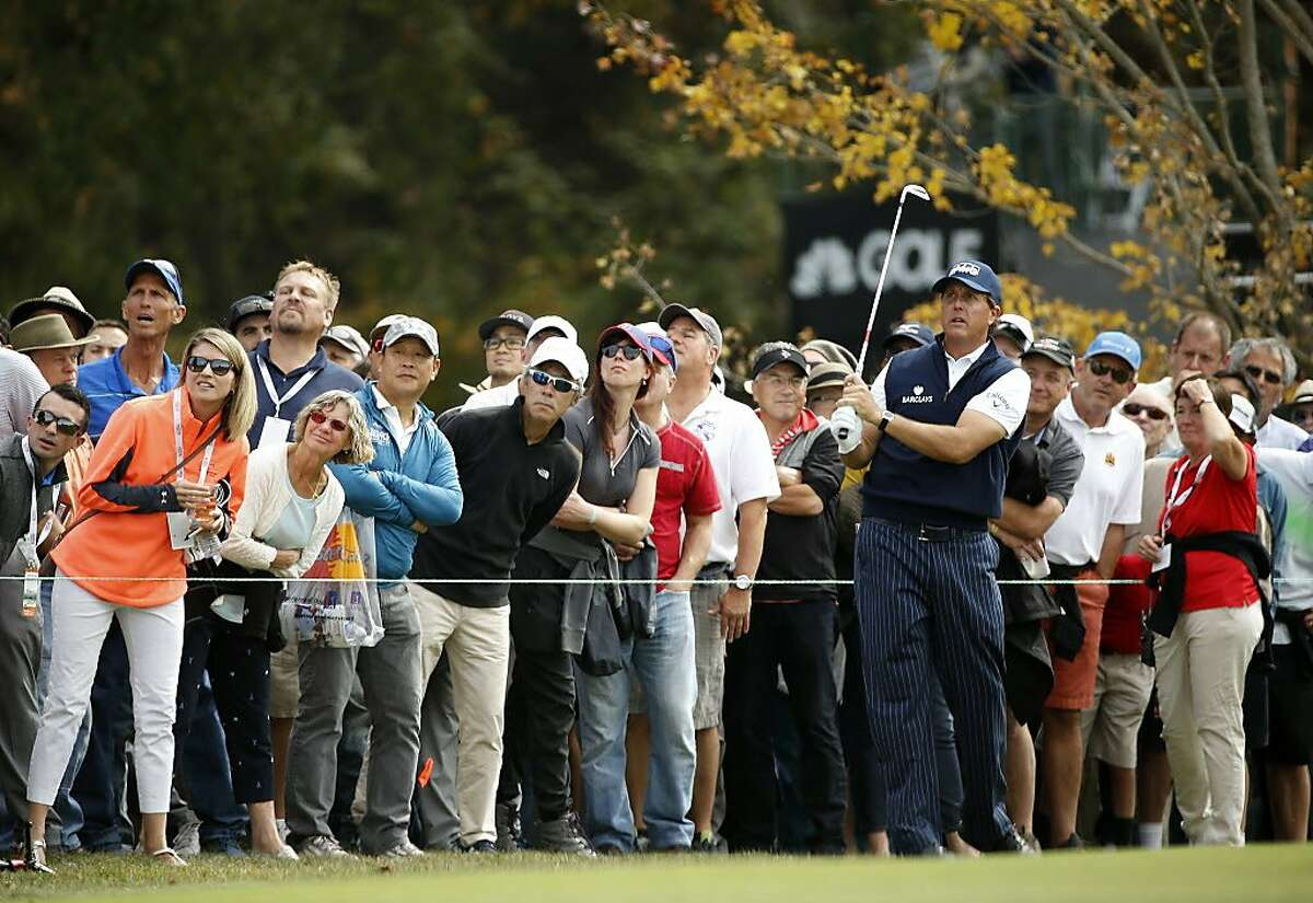 Phil Mickelson along with the gallery watch his fairway shot on the 3rd hole during round 1 of the Safeway Open golf tournament at the Silverado Resort in Napa, California, on Thursday October 13, 2016