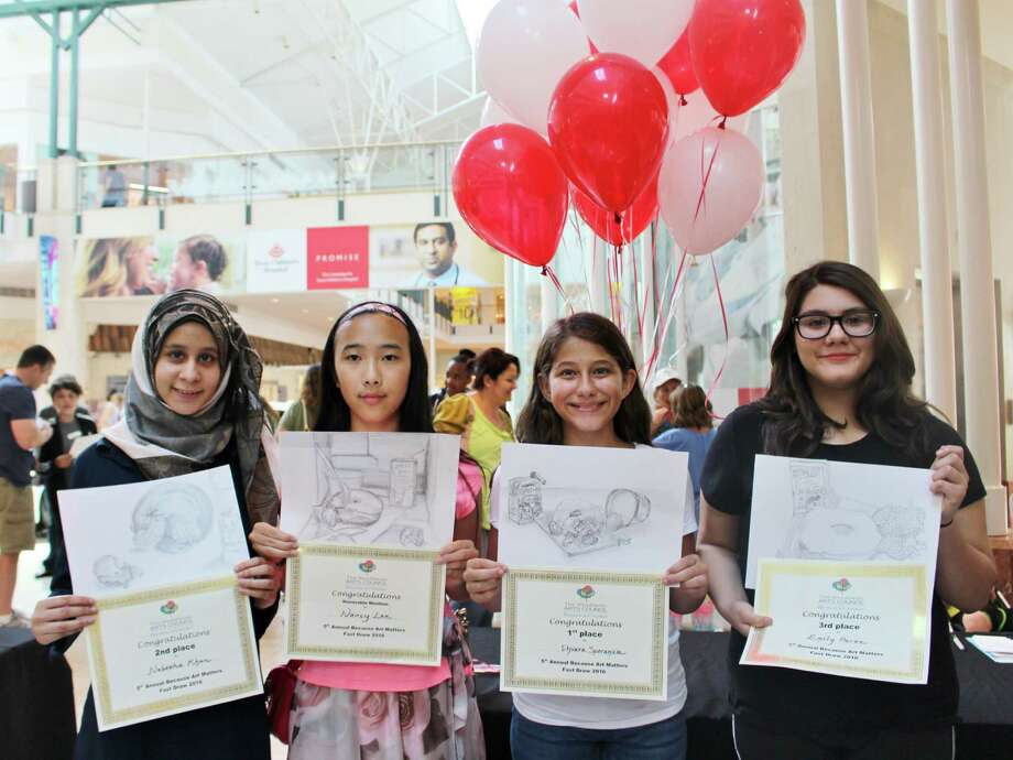 Three Conroe ISD students took top awards at the recent BAM! (Because Art Matters) Fast Draw Competition. BAM! Winners were Chiara Speranza, first place, seventh-grader from McCullough Junior High; Nabeeha Khan, second place, eighth-grader from McCullough Junior High; and Emily Perez, third place, eighth-grader from Washington Junior High. Photo: Submitted