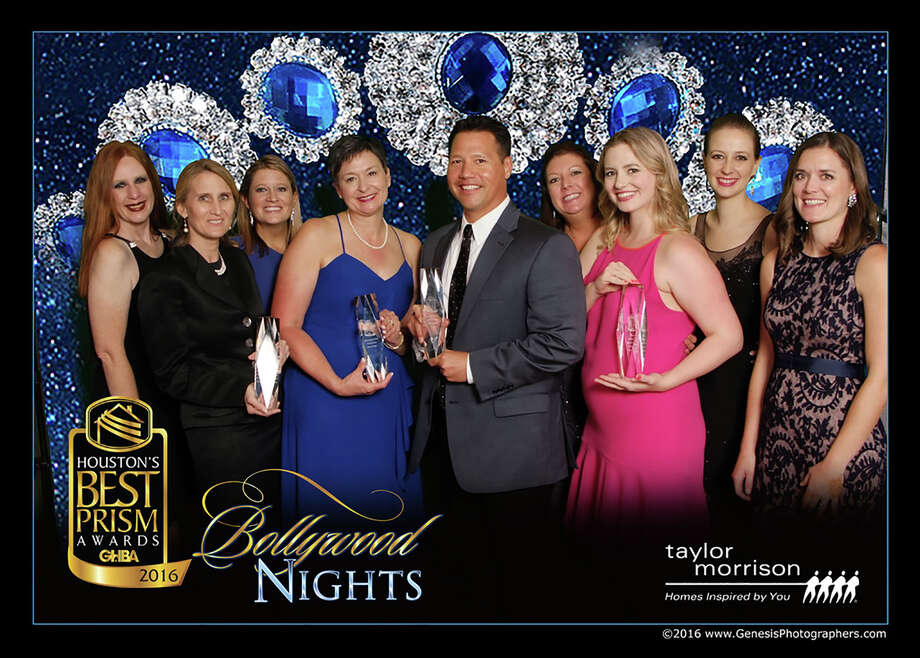 The team at Bridgeland and The Woodlands proudly display their Greater Houston Builders Association Houston's Best PRISM Awards. From left to right are: Kimberly Elliott, Kim Phillips, Martha Gros, Debbie Hickman, Heath Melton, Lona Shipp and Audrey Seykora along with representatives from MMI Agency - Ashley Hess and Christine Forbes. Photo: Submitted, Photographer / Copyright Genesis Photographers 2016