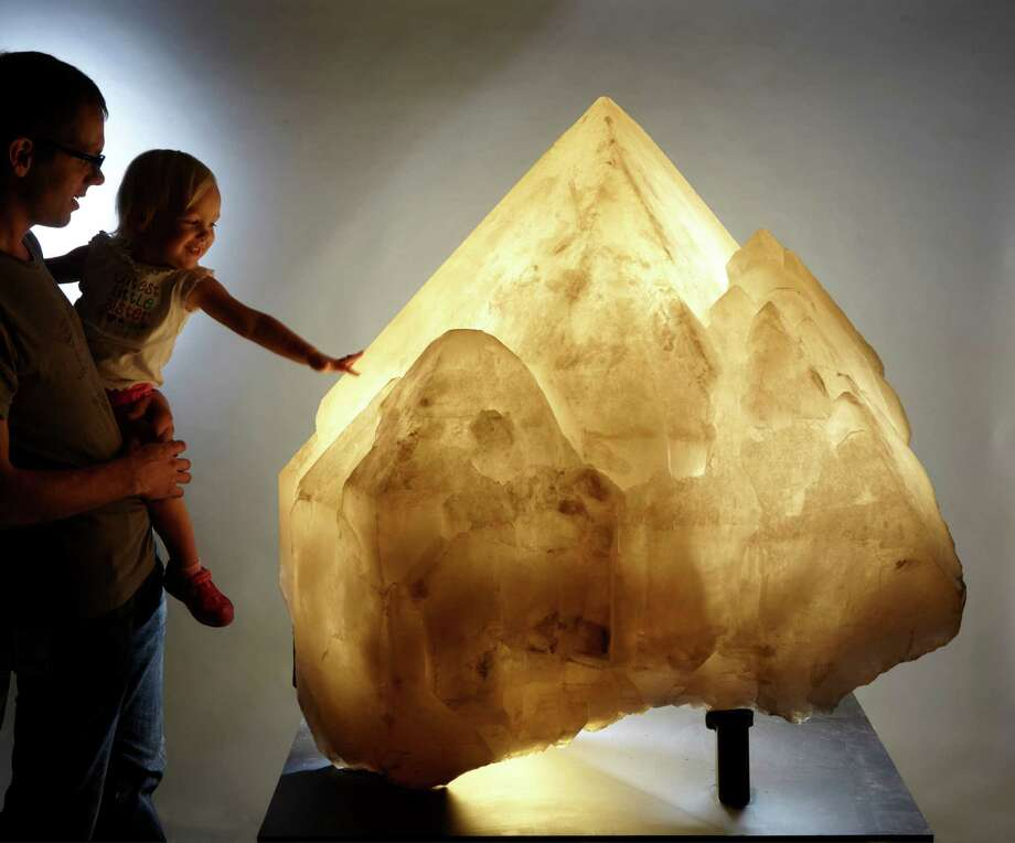 Nate Utrup and his daughter are pictured in front of a giant quartz from Namibia, one of the largest mineral specimens in the new David Friend Hall. It opens to the public on Sunday, Oct. 23. Photo: Yale Peabody Museum / Contributed Photo