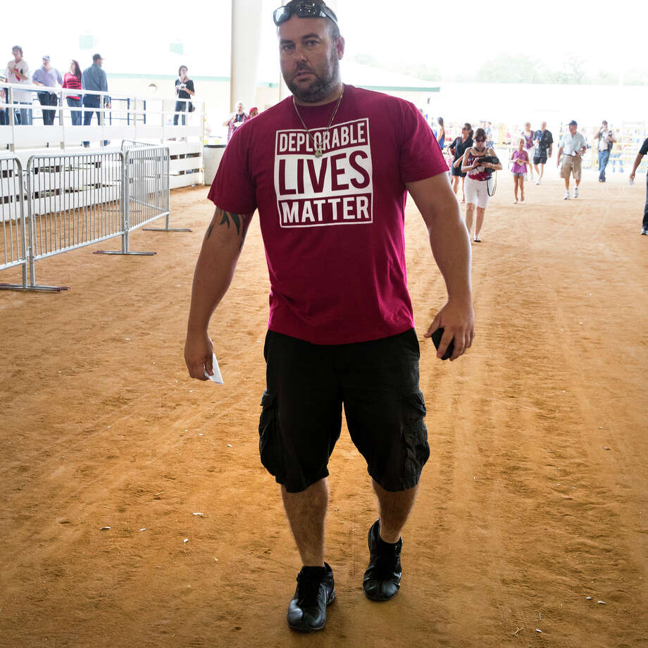 "A Donald Trump supporter wearing a ""Deplorable Lives Matter"" T-shirt arrives at a campaign rally in Ocala, Florida. Or readers comment on the increasingly contentious presidential race between Trump and his Democratic rival Hillary Clinton. Photo: STEPHEN CROWLEY /NYT / NYTNS"