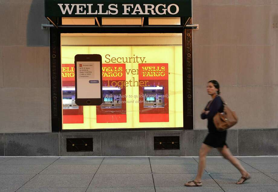 To help recover from the scandal, Wells has announced a series of changes in how it deals with customers. Every customer will get an email after an account is opened to confirm the person opened it, and electronic signatures will be required on all new checking, savings and credit card account applications. Photo: Andrew Caballero-Reynolds /AFP /Getty Images / AFP or licensors