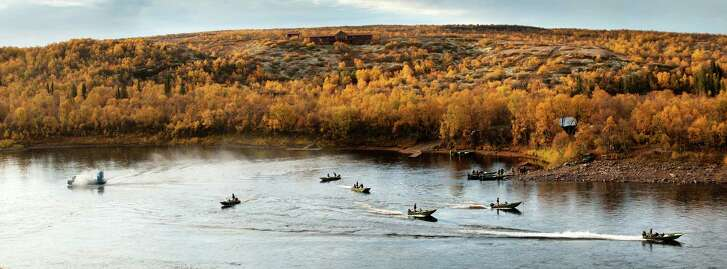 Boats depart the Ryabaga Camp on Russia's Ponoi River, one of the world's most celebrated Atlantic salmon fisheries. A prime week here can cost more than $15,000 per person.