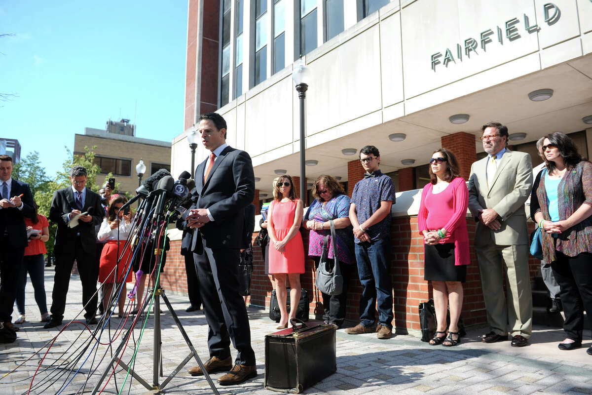 Attorney Joshua Koskoff stands with Sandy Hook family members as he speaks to a large group of media gathered in front of the Fairfield County Courthouse, in Bridgeport, Conn. June 20, 2016. On Friday Superior Court Judge Barbara Bellis threw out the lawsuit against the gun maker brought by the families of the Sandy Hook tragedy.