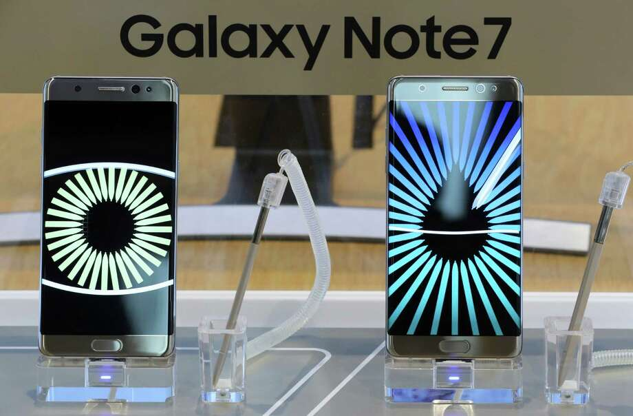 Passengers and flight crews will be banned from bringing Samsung Galaxy Note 7 smartphones on airline flights under an emergency order issued Friday by the Department of Transportation in response to reports of the phones catching fire. Photo: Lee Jin-man /Associated Press / Copyright 2016 The Associated Press. All rights reserved.