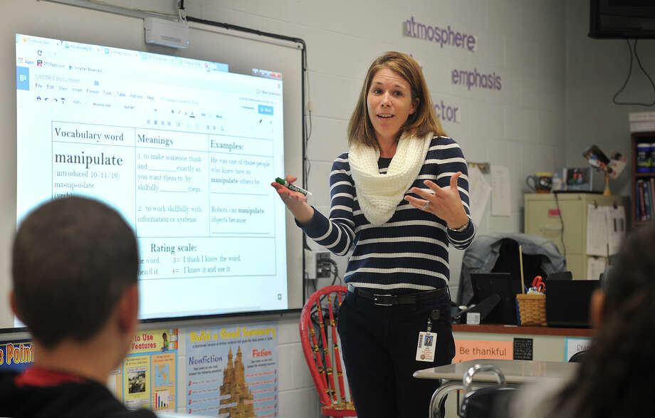 """Reading Consultant Alison Rahn introduces the vocabulary word """"manipulate"""" to students at Shelton Intermediate School in Shelton, Conn. on Tuesday, October 11, 2016. The school district celebrates a word of the week, which teachers use throughout the week in all areas of the school's curriculum. Photo: Brian A. Pounds / Hearst Connecticut Media / Connecticut Post"""