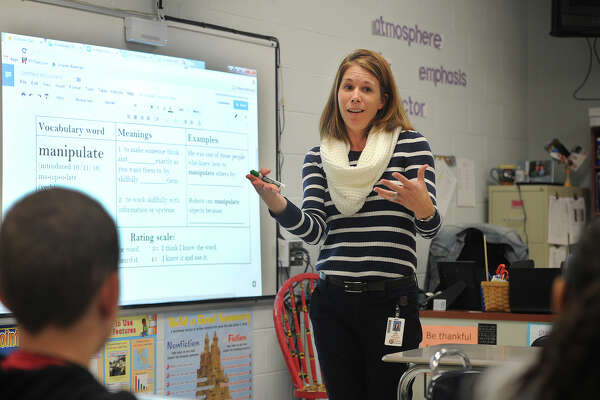 "Reading Consultant Alison Rahn introduces the vocabulary word ""manipulate"" to students at Shelton Intermediate School in Shelton, Conn. on Tuesday, October 11, 2016. The school district celebrates a word of the week, which teachers use throughout the week in all areas of the school's curriculum."