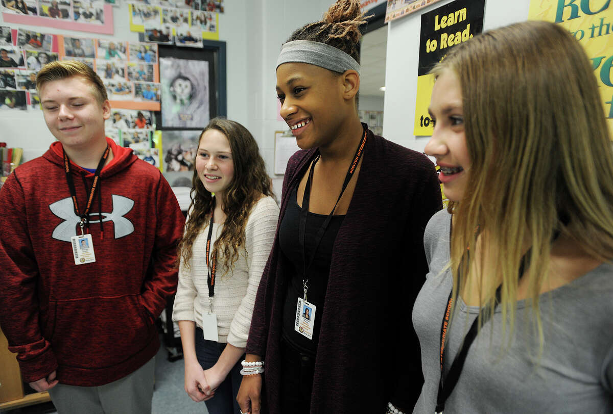A group of Shelton Intermediate School eighth-graders, including, from left, Michael Kiwak, Samantha Rago, Clarissa Pierre, and Kassidy Wojtowicz, talk about their work on building vocabulary. The four are among students who recently won a vocabulary contest on the website Flocabulary.com