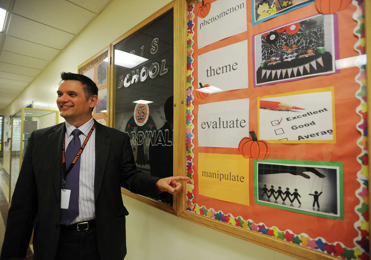 Shelton Intermediate School Headmaster Kenneth Saranich stands by the school's Word Wall on Tuesday