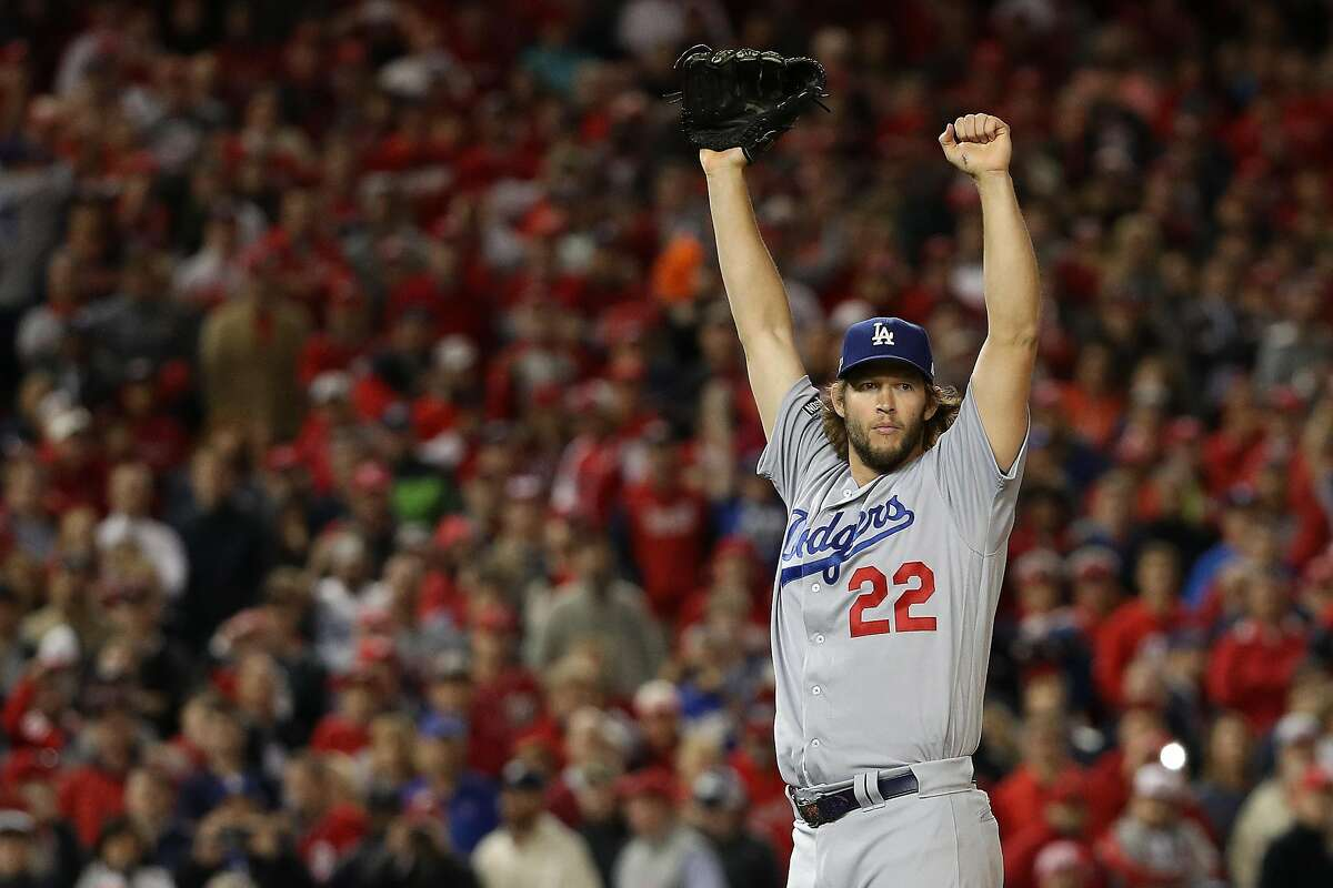 WASHINGTON, DC - OCTOBER 13: Clayton Kershaw #22 of the Los Angeles Dodgers celebrates after winning game five of the National League Division Series over the Washington Nationals 4-3 at Nationals Park on October 13, 2016 in Washington, DC. (Photo by Patrick Smith/Getty Images)