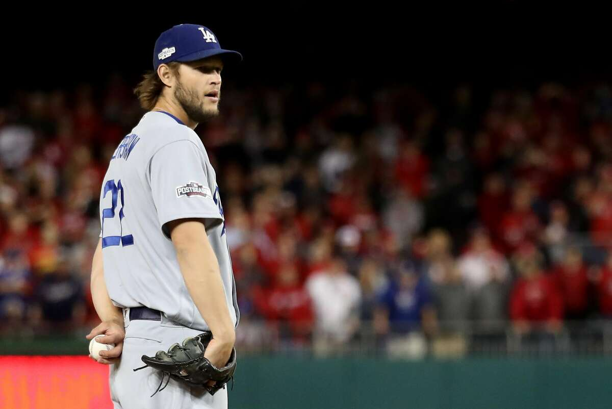 WASHINGTON, DC - OCTOBER 13: Clayton Kershaw #22 of the Los Angeles Dodgers works against the Washington Nationals in the ninth inning during game five of the National League Division Series at Nationals Park on October 13, 2016 in Washington, DC. (Photo by Rob Carr/Getty Images)