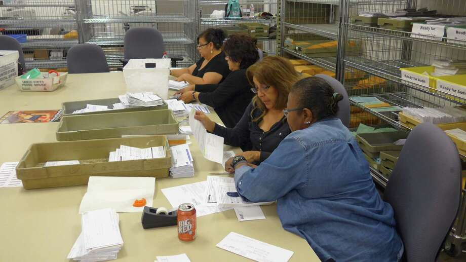 Bexar County Elections Department workers sort mail applications on Friday, Oct. 14, 2016 Photo: John W. Gonzalez, Express-News Staff / John W. Gonzalez, Express-News Staff