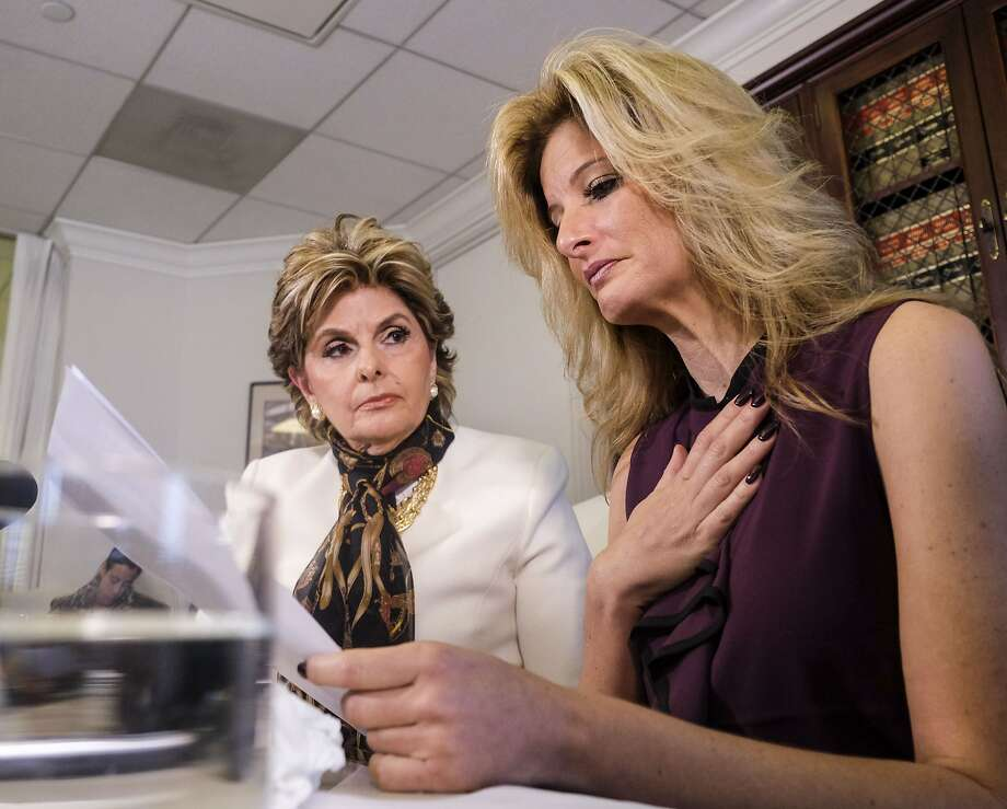"Attorney Gloria Allred, left, looks on as Summer Zervos reads a statement during a news conference in Los Angeles, Friday Oct. 14, 2016. Zervos, a former contestant on ""The Apprentice"" says Republican presidential candidate Donald Trump made unwanted sexual contact with her at a Beverly Hills hotel in 2007. Zervos is among several women who have made sexual allegations against the Republican nominee. He has strenuously denied them.  Photo: Ringo H.W. Chiu, Associated Press"