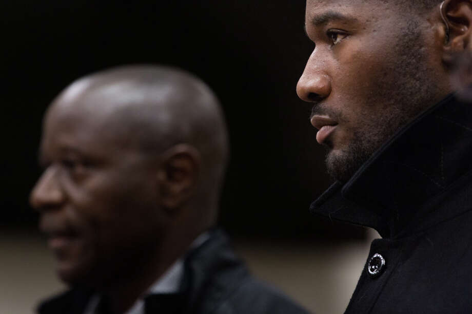 Former Seahawks fullback Derrick Coleman, right, listens to his father, Derrick Coleman Sr., speak to the court during his sentencing for felony hit-and-run and vehicular assault, in Seattle on Friday, Oct. 14, 2016. Photo: GRANT HINDSLEY, SEATTLEPI.COM / SEATTLEPI.COM