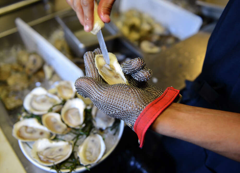 Never slurped down a Copps Island oyster at a raw bar? You might have and not known it. Photo: Christian Abraham / File Photo / Connecticut Post