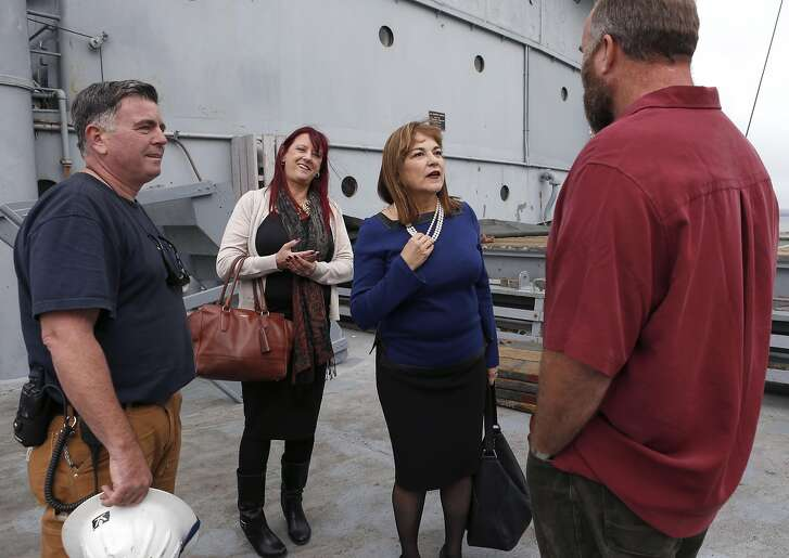 Rep. Loretta Sanchez speaks with Aaron Leonard (right) and Phil O'Mara (left), the shipkeeper of the USS Jeremiah O'Brien, before she meets with maritime union leaders, including Marina Secchitano (background), in San Francisco, Calif. on Wednesday, Oct. 12, 2016. Sanchez is trailing in her race against Atty. Gen. Kamala Harris for the US Senate seat being vacated by Barbara Boxer.