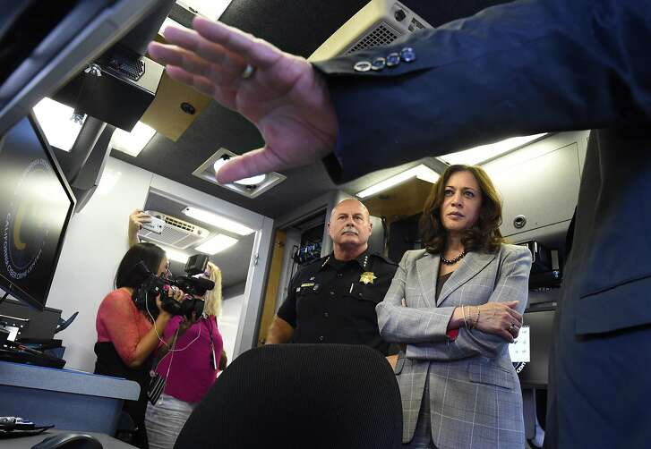 State Attorney General Kamala Harris and Fresno Chief Jerry Dyer get a tour from Department of Justice software specialist Tim Whitfield, right, of the Cyber Response Vehicle (CRV), at Fresno State, Monday afternoon, Oct. 10, 2016, which will help local law enforcement throughout California perform efficient and advanced criminal investigations with a technology component like e-mail recovery, social media investigations, and advanced mobile forensics.