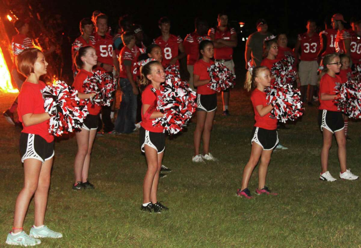 A young spirit team encourages the fans to cheer at the homecoming bonfire on Oct. 13 at the Coldspring-Oakhurst High School.