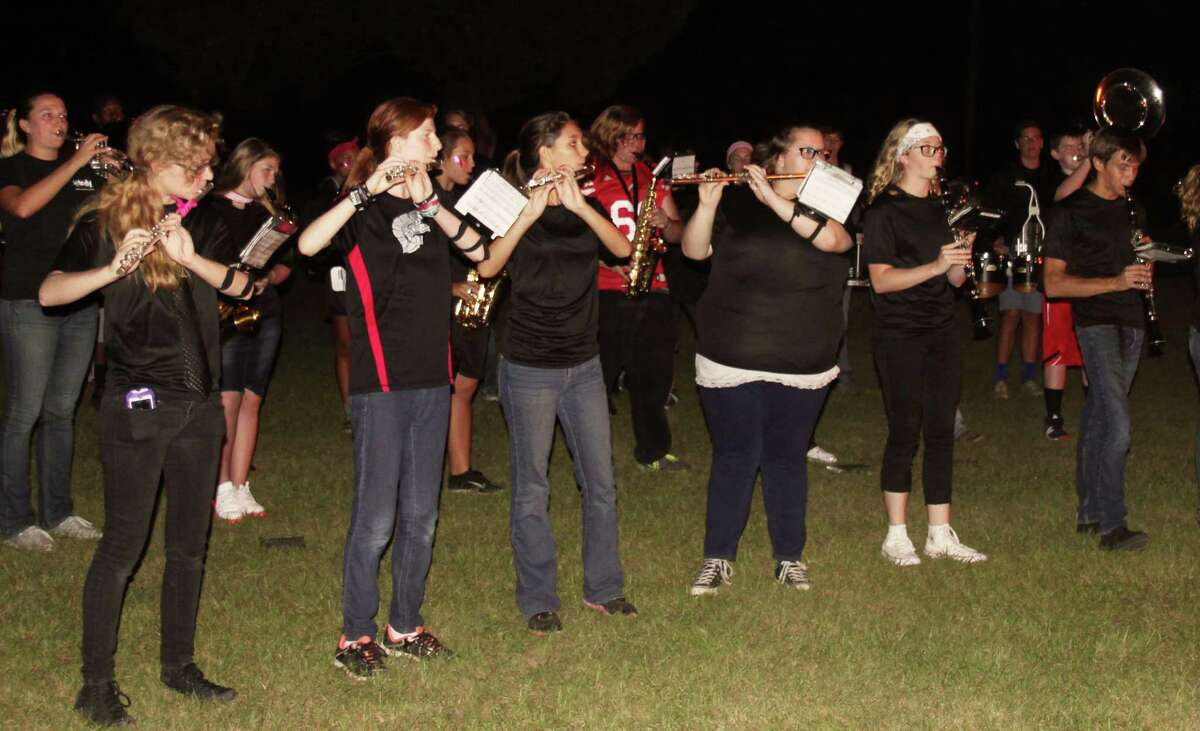 The Trojan Band entertains the crowd with a performance during the Trojan bonfire.