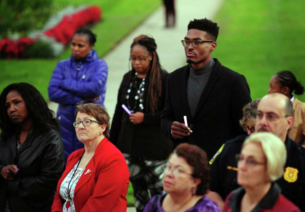 Brandon Sherrod, center, attends a Domestic Violence Awareness Vigil held by the Center for Family Justice in Stratford.