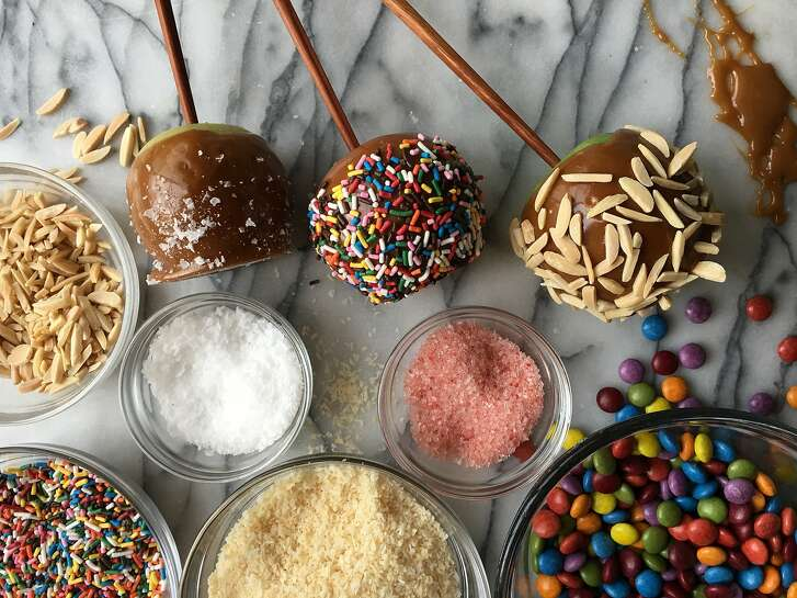 Caramel apples are a festive fall time treat that can be customized by adding your favorite kinds of toppings, such as chopped nuts, flaked sea salt and even colorful sprinkles.