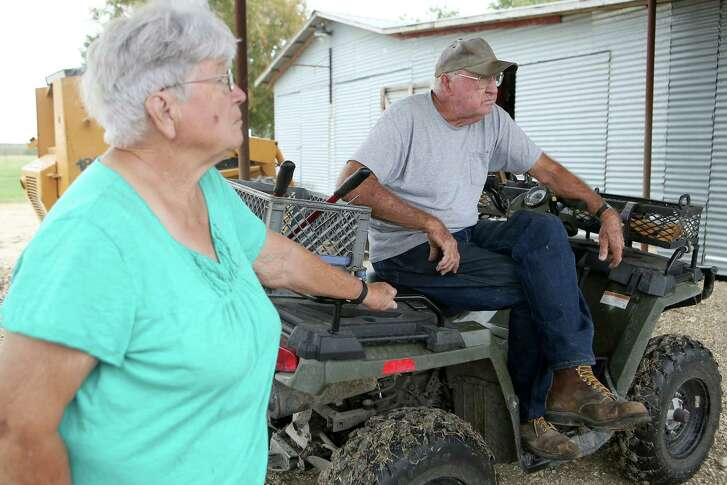 Beth and Roy McDonald take a break from work Thursday, Oct. 13, 2016 on their property just outside Lockhart. The McDonald's property lies on the Vista Ridge pipeline route and they are facing an eminent domain fight since they are not interested in having another easement on their land. They already have easements for high voltage power lines, oil pipelines and other water lines.
