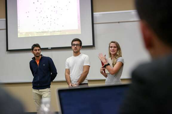 "(left to right) Kian Katanforoosh, Berk Coker, and Katie Joseff receive feedback after their presentation during the ""Hacking for Diplomacy"" class at Stanford University on Thursday, October 13, 2016."
