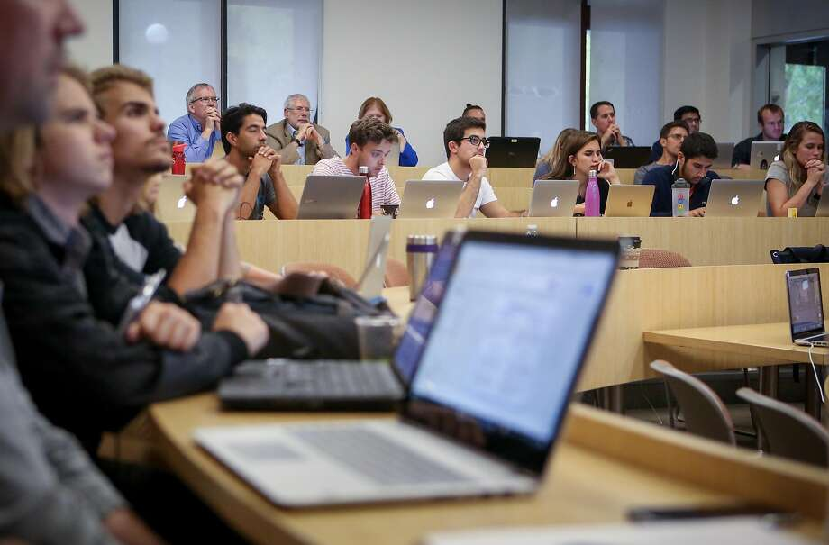 The Hacking for Diplomacy class, right, listens to a presentation by students. Political science Professor Jeremy Weinstein, below, is one of the class' instructors. Photo: Amy Osborne, Special To The Chronicle