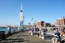 South of the Spinnaker Tower, the Millennium Promenade hugs the water and leads to Portsmouth's quaint historic district.