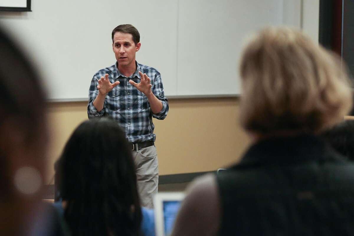 Professor Jeremy Weinstein addresses students in the