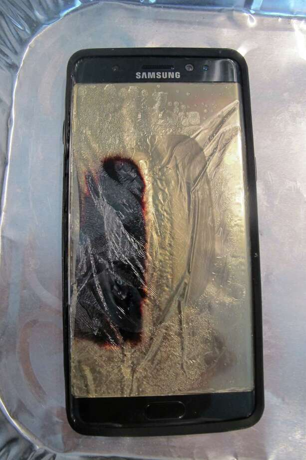This replacement Galaxy Note 7 smartphone released smoke and sizzled. Samsung said it is halting sales of the Galaxy Note 7 after a spate of fires involving new devices that were supposed to be safe replacements for recalled models. Photo: Audrey McAvoy /Associated Press / AP