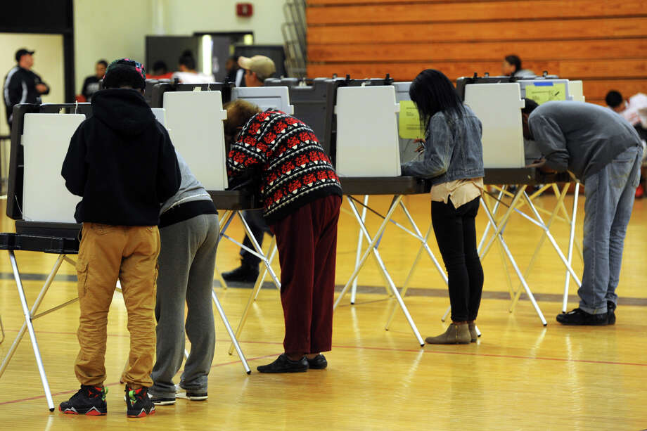 Election Day voting at Central High School, in Bridgeport in 2015. Photo: Ned Gerard / Hearst Connecticut Media / Connecticut Post