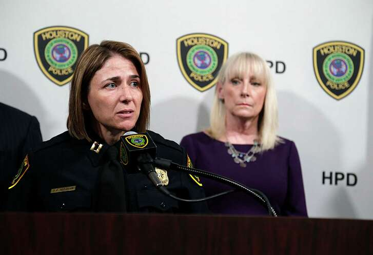 Houston Police Department Captain Dana Hitzman speaks as Houston Area Women's Center President Rebecca White, right, looks on during a press conference discussing HPD's and the Houston Area Women's Center joint efforts to combat domestic violence. (Photo: James Nielsen / Houston Chronicle )