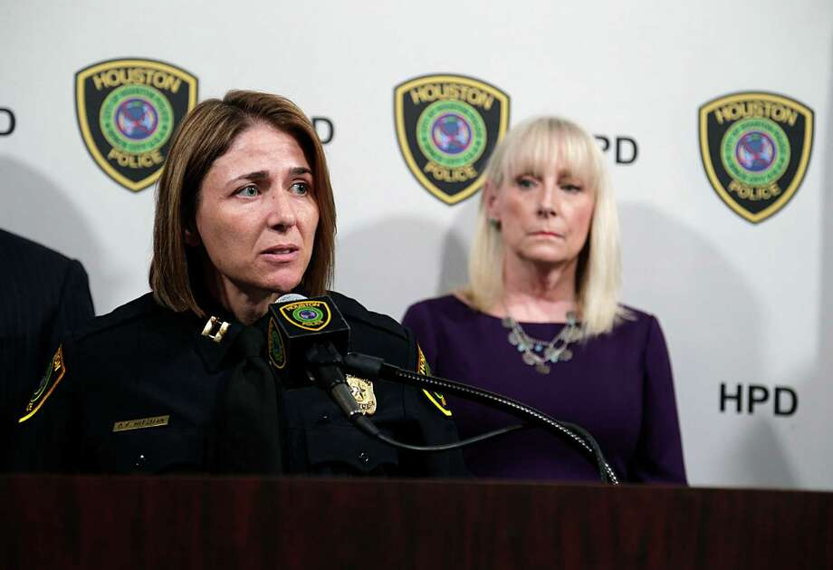 Houston Police Department Captain Dana Hitzman speaks as Houston Area Women's Center President Rebecca White, right, looks on during a press conference discussing HPD's and the Houston Area Women's Center joint efforts to combat domestic violence. (Photo: James Nielsen / Houston Chronicle ) Photo: James Nielsen, Staff / © 2016  Houston Chronicle
