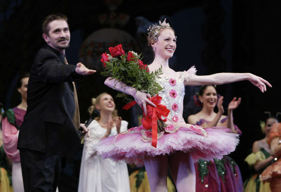 Sara Webb is introduced by Houston Ballet artistic director Stanton Welch as a new principal after a performance Friday evening November 28, 2003 at Brown Theater in Wortham Theater Center, 501 Texas Ave. Houston, Texas. -- (photograph by D. Fahleson, Houston Chronicle Staff Photojournalist)  HOUCHRON CAPTION (12/01/2003):  Houston Ballet's Sara Webb may have lost her Prince to an injury midway through their Nutcracker grand pas de deux, but she gained a promotion. Artistic director Stanton Welch introduced Webb as the company's newest principal dancer following Friday's performance. Photo: D. Fahleson, Staff / Houston Chronicle