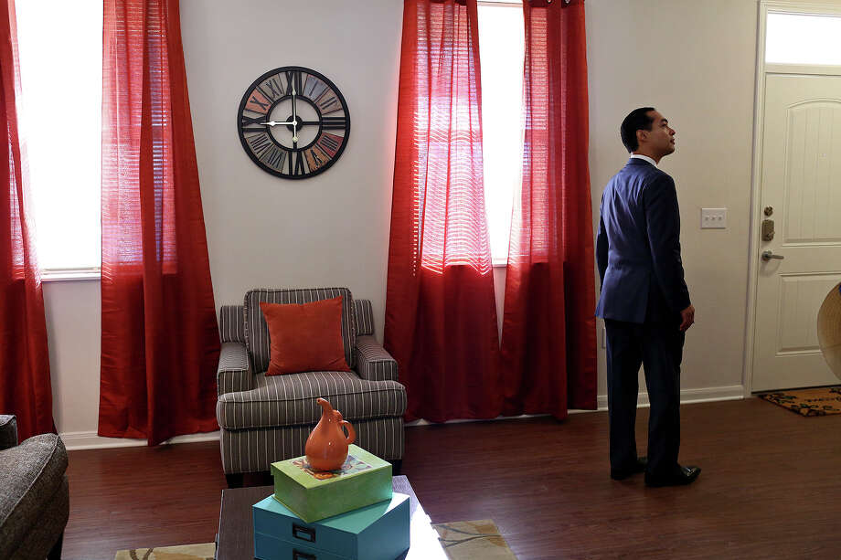 U.S. Department of Housing and Urban Development Secretary Julián Castro, a former San Antonio mayor, tours an apartment at the new East Meadows housing development at a formal unveiling for the San Antonio Housing Authority property Friday. East Meadows was built where the Wheatley Courts public housing complex used to stand. Photo: Lisa Krantz /San Antonio Express-News / ©2015 San Antonio Express-News