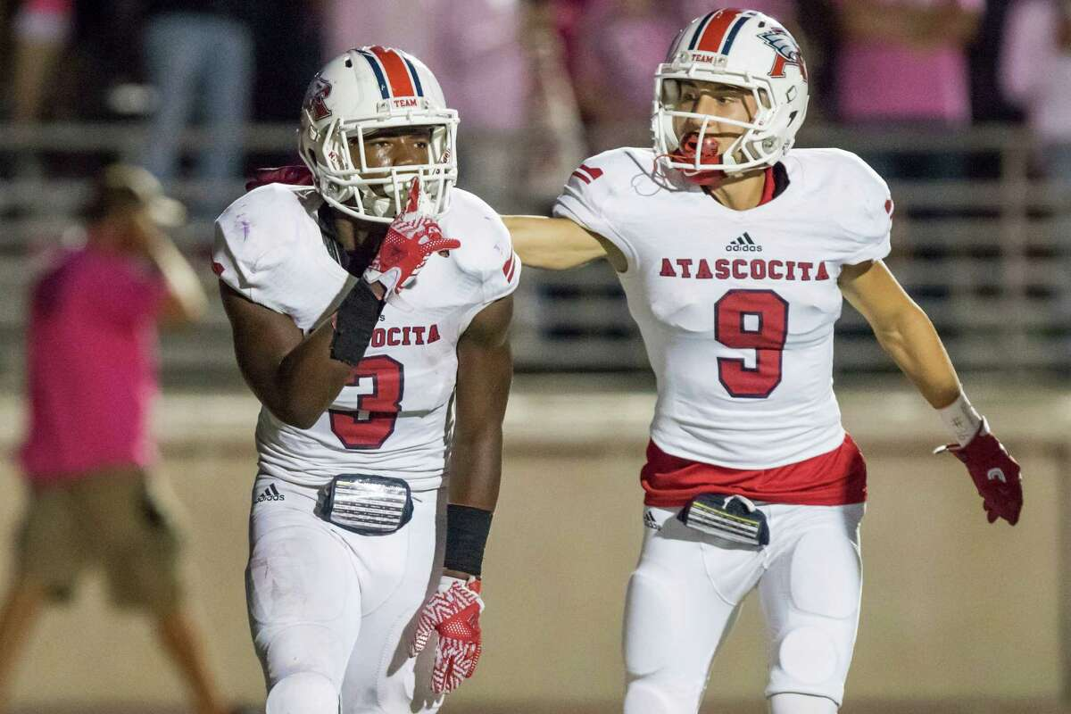 Atascocita running back Decarlos Demmerritte (3) silences the crowd after scoring a touchdown in a high school football game at Turner Stadium on Friday, October 14, 2016, in Humble.