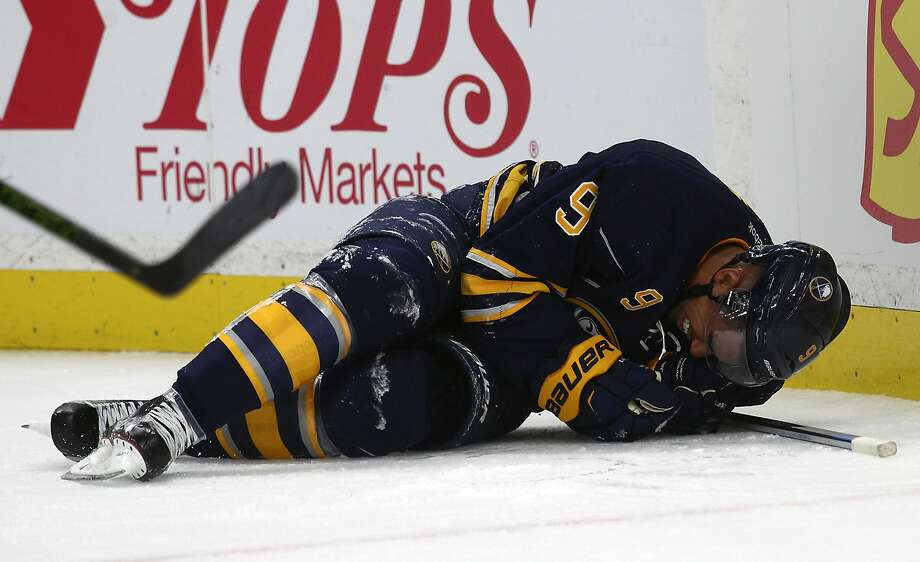 Buffalo left wing Evander Kane was hurt when he crashed into the boards Thursday night. Photo: Jeffrey T. Barnes, Associated Press