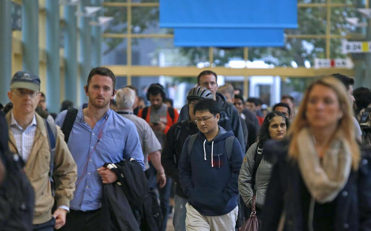 Commuters walk through the Caltrain Station at Fourth and Townsend streets in San Francisco, Calif. on Friday, Oct. 14, 2016.