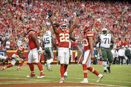 Kansas City Chiefs defensive back Marcus Peters (22) celebrates his interception against the New York Jets with defensive back Phillip Gaines during the second half of an NFL football game in Kansas City, Mo., Sunday, Sept. 25, 2016. (AP Photo/Ed Zurga)