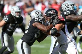Atlanta Falcons tackle Jake Matthews (70) battles with Khalil Mack (52) in action against the Oakland Raiders during an NFL football game Sunday, Sep. 18, 2016, in Oakland, CA. The Falcons won 35-28. (Daniel Gluskoter/AP Images for Panini)
