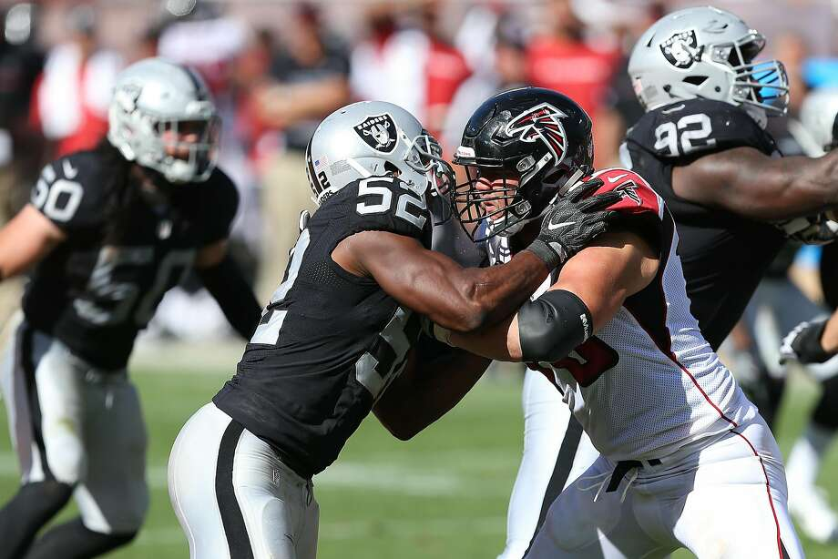 The Raiders blame the low sack total of defensive end Khalil Mack (52) on rivals' constant holding. Photo: Daniel Gluskoter, Associated Press