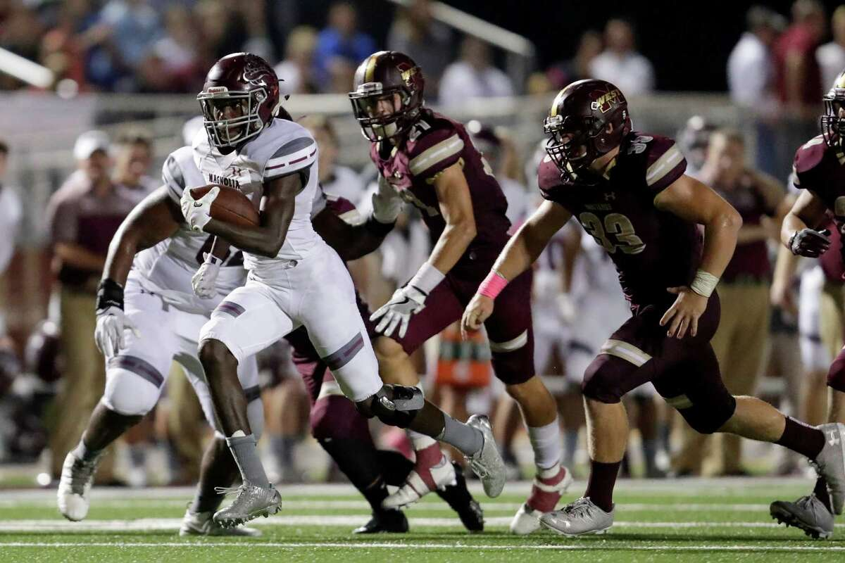 Magnolia Bulldogs running back Darren Battle (11) breaks free and rushes for a touchdown in the fourth quarter during the high school football game between the Magnolia Bulldogs and the Magnolia West Mustangs at Mustang Stadium in Magnolia, TX on Friday, October 14, 2016. The Bulldogs lead the Mustangs 21-14 in the fourth quarter.