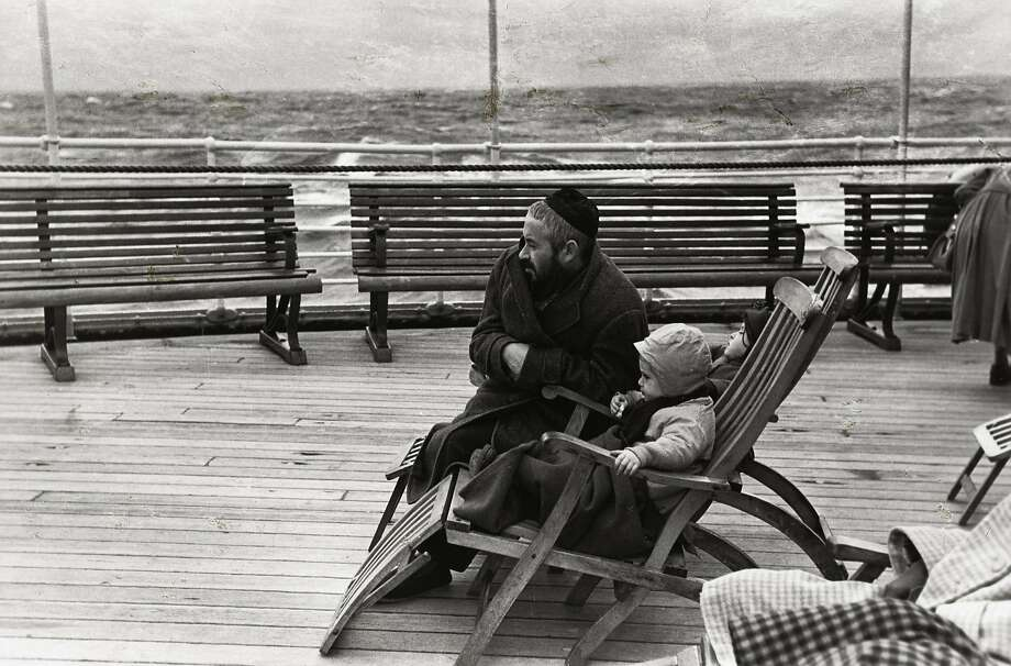 "Louis Stettner photographed an immigrant father and child on a ship in ""Coming to America"" (1951). Photo: Louis Stettner"