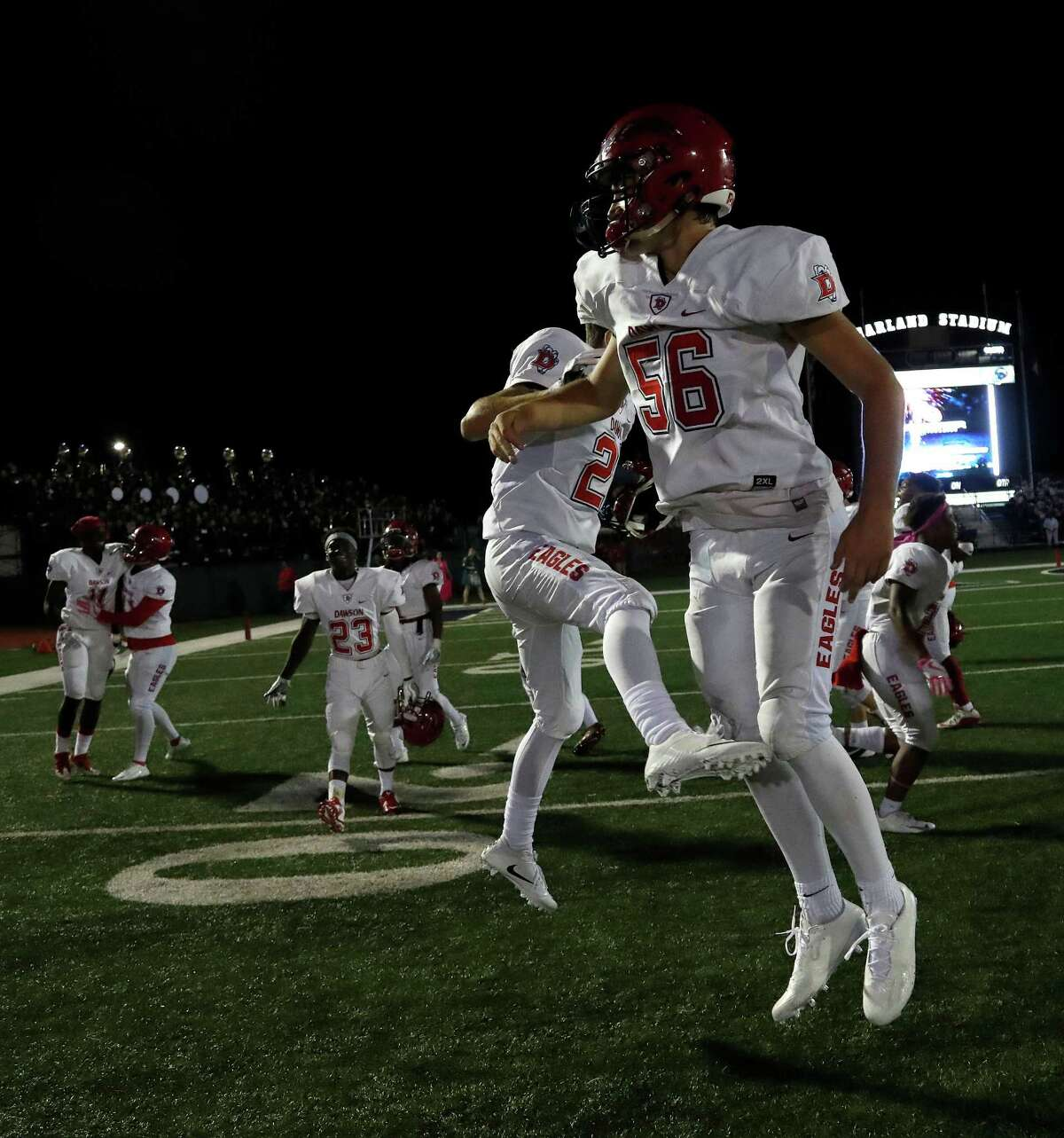 Dawson's Christopher Ruffino (29) and Michael Largent (56) celebrate their 34-32 win over Pearland after a District 23-6A high school game between Pearland and Dawson, Friday,Oct. 14, 2016 in Pearland.