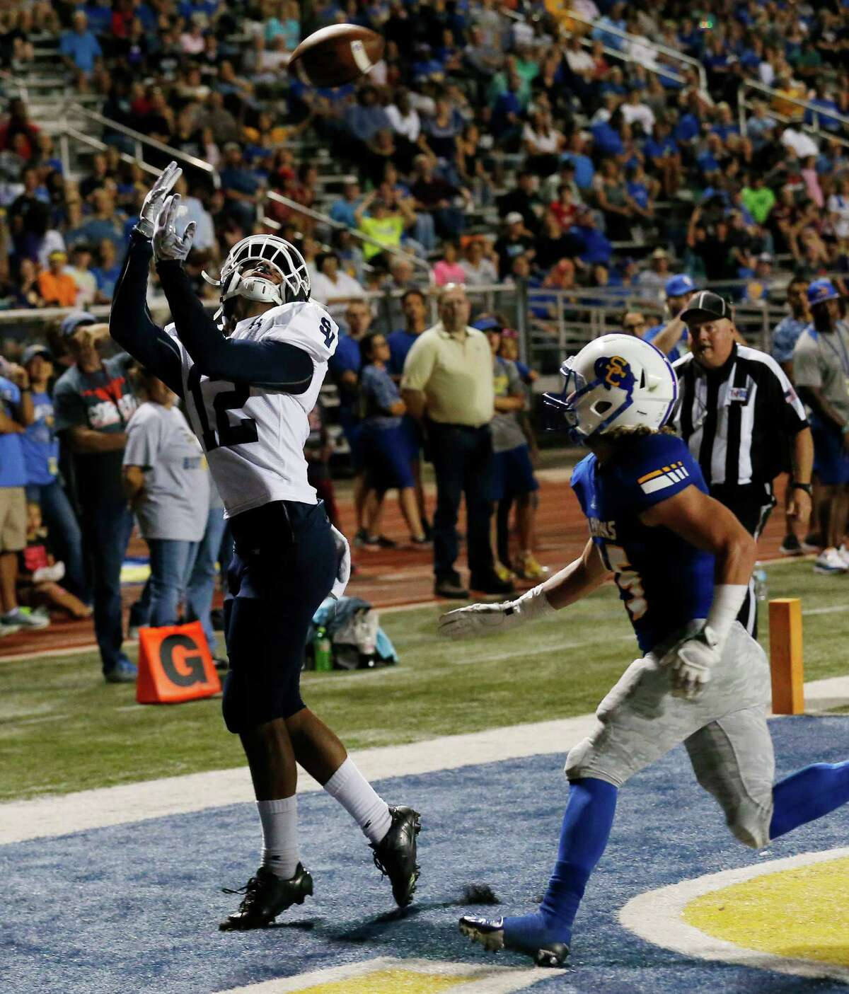 Smithson Valley's Edwin Martinez (12) makes a five-yard pass reception for a touchdown against Clemen's Dalton Polson (25) during their game at Lehnhoff Stadium on Friday, Oct. 14, 2016.